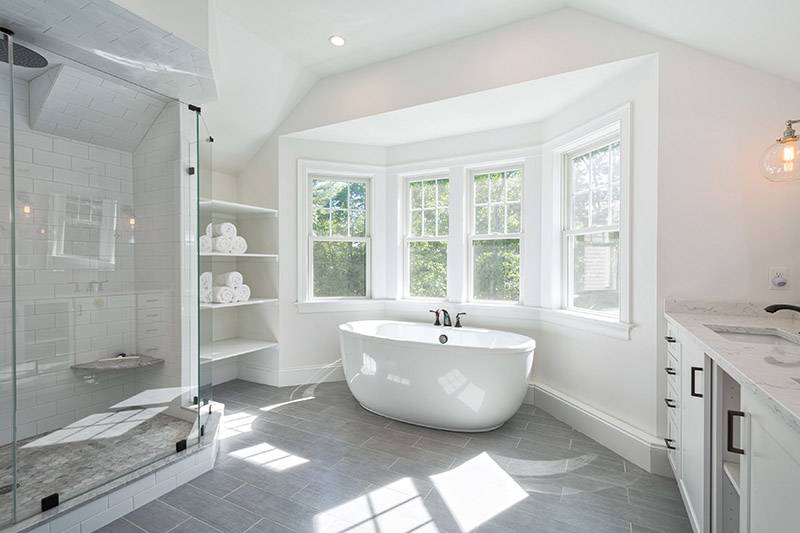 A Bright, Modern Bathroom During The Day In A Brand New Home.