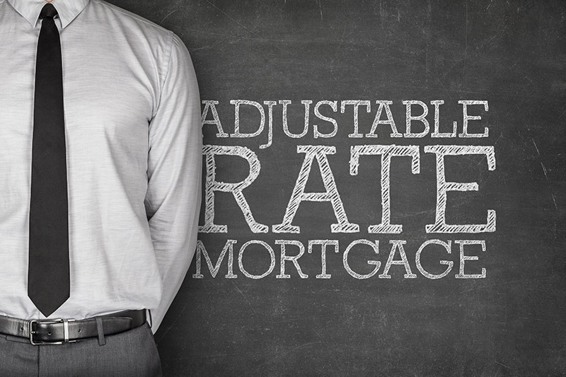 An Unseen Broker Discussing The Pros & Cons Of Adjustable Rate Mortgages.