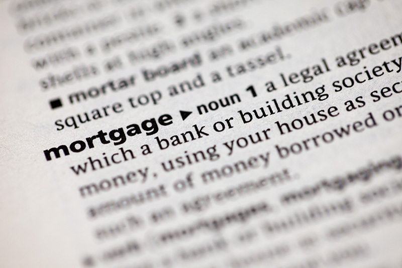 Close Up View Of The Definition Of Mortgage And Other Financing Terms.