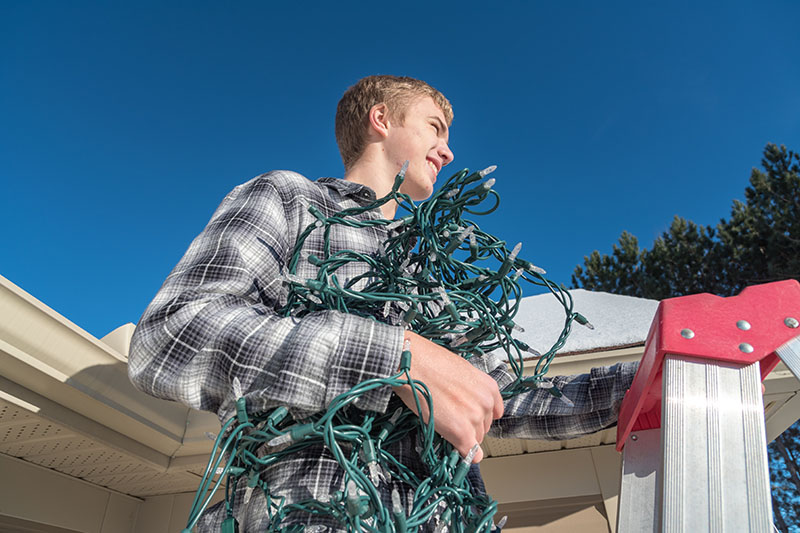 Tips For Safely Putting Up Christmas Lights On Your New Home.