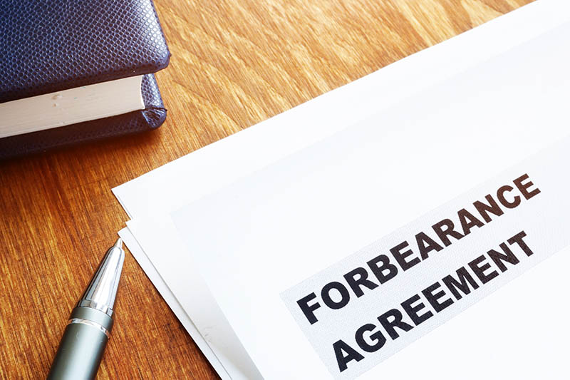 Forbearance Agreement Waiting To Be Signed By Homeowner Impacted By COVID-19.