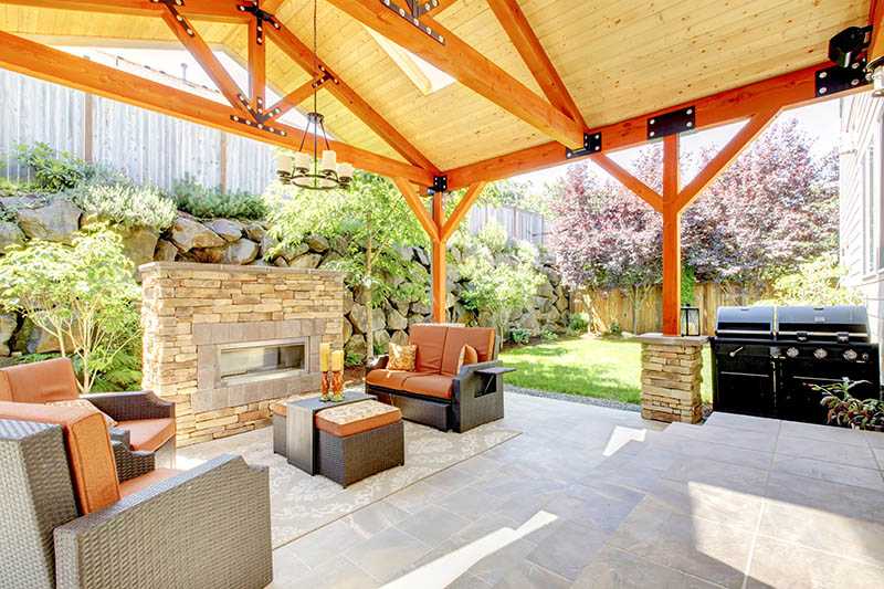 A Home With A Beautiful Backyard Hardscape Patio And Gazebo.